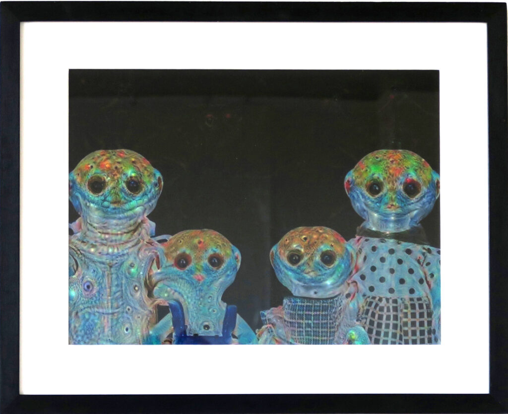 Framed print of a family group of four animal like figures in psychedelic colors